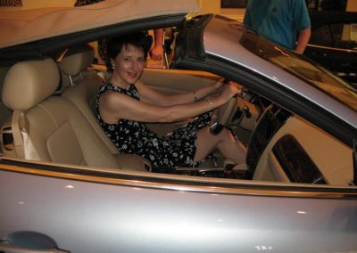 Kathleen sitting in a Jaguar car