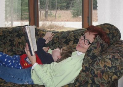 Author Kathleen Paterka reading to her grandson