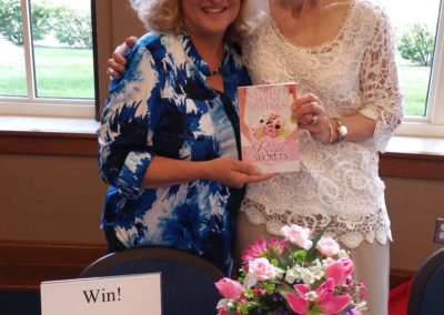 Kathleen at a book signing with a reader fan